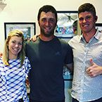 Golfer Jon Rahm and orthodontists Drs. Megan and Matt Lineberger in Charlotte, Huntersville, and Mooresville