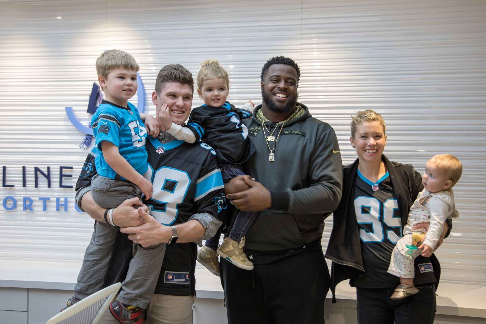 Kawann Short of the Carolina Panthers and Drs. Megan and Matt Lineberger in Charlotte, Huntersville, and Mooresville